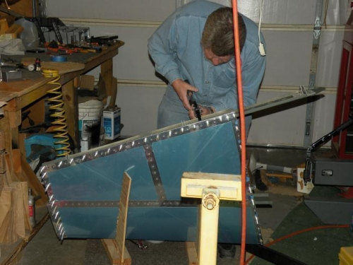 Me riveting the skin to the rear spar.
