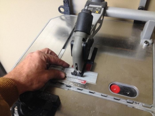 Used this handy wall mount table jig saw with metal blace to cut the tie down spacers to size