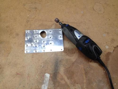using the dremel tool to shape up the aleron push rod hole