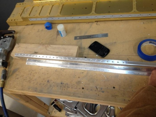 Holes dimpled on the spar that woud be hard to get to once the 707G reinforcement fork is riveted on