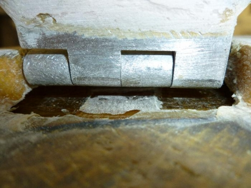 Wedge in place to hold hinge up