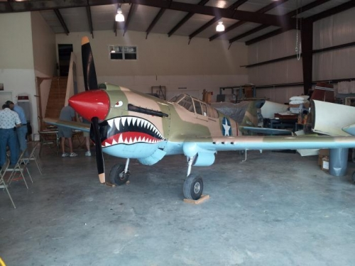nice 2/3 scale P-40 in the hanger/workspace.  There was also a velocity