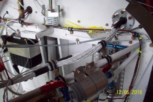 EMS harness wires threaded through the firewall and across the upper firewall stiffener.