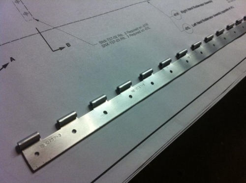 First hinge drilled with fixture