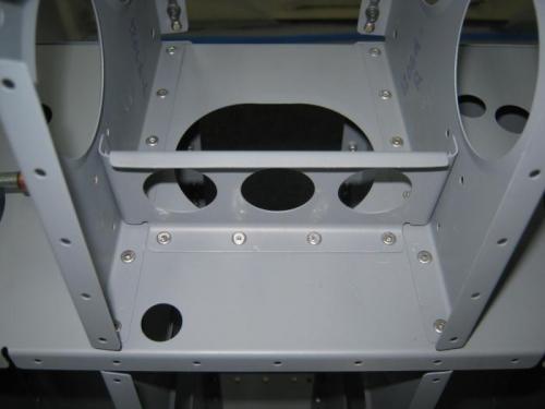 Rivet the F1207 bearing bracket brace to the F1206a bulkhead