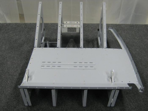 Install seat floor to the right seat rib assy and pulley bracket seat rib assy
