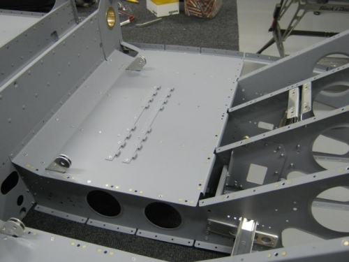 Rivet the right seat floor assy to the F1204A center section bulkhead