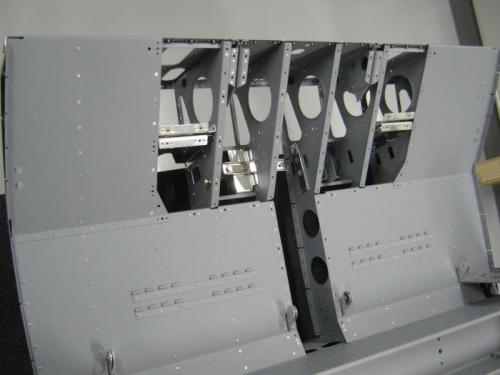 Riveted seat ramp floors