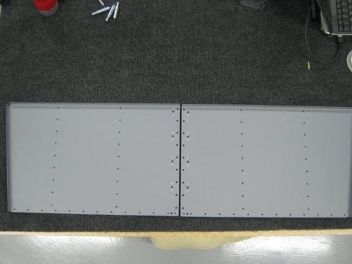 Installed nut plates on F1213 step floors