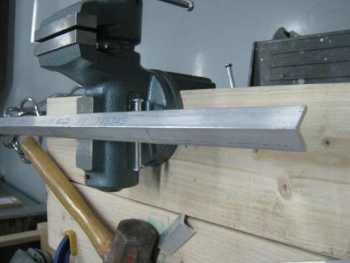 Prepping longeron for hammering
