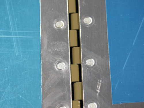 Hinges Mounted Using Square Cutouts As Reference