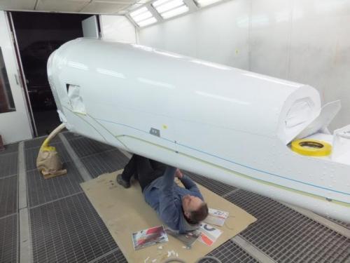 Richard under aircraft.