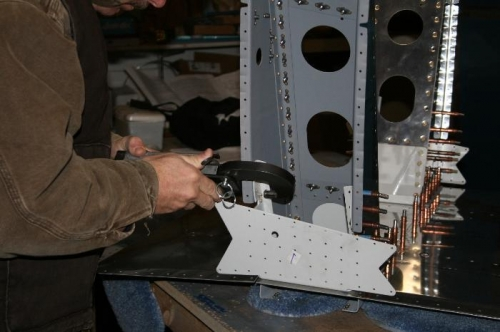 Squeezing the rivets that attach the weldment (light gray) to the gear tower.