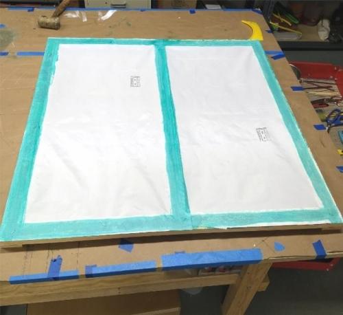 Fabric on frame awaiting shrink