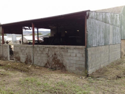 Sheeting removed. Wall height to be raised