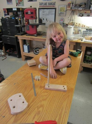 Marking dowel lengths for Daddy to cut.