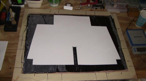 Carbon Fiber laid out and cardboard template ready.