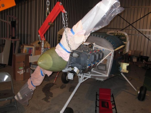 Using the engine hoist to get the prop in place