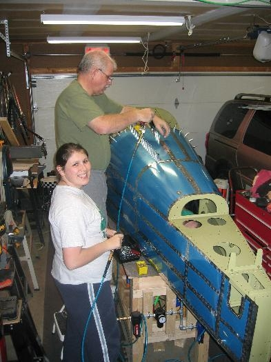 Renee helping with the clecos, Bob driving rivets, and Brad bucking from inside