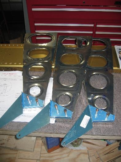 Three of the flap hinge bracket assemblies