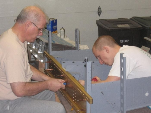 Bob & Brad riveting the inboard seat rib to the aft center section bulkhead