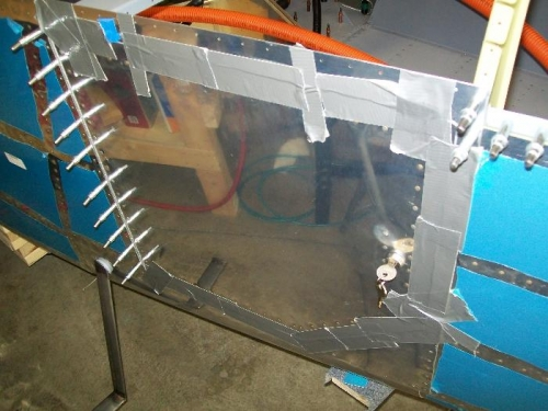 Baggage door held in place with duct tape for alignment