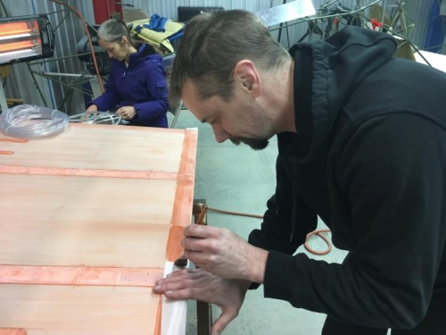 Bryan applying trailing edge tape