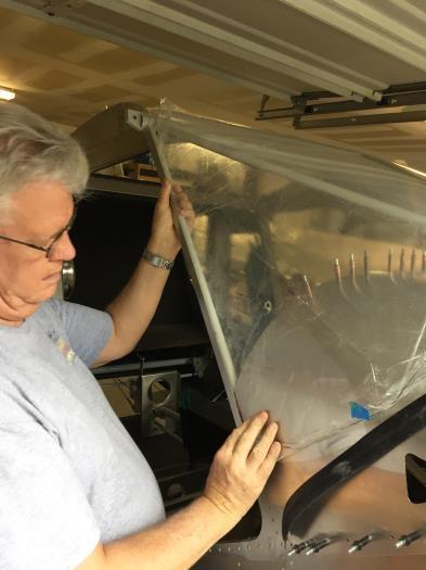 Adjusting side of windshield