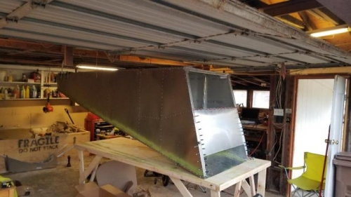 Riveted front and rear baggage compartment together