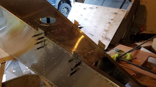 riveted the top skin doubler, rear l angle, and clecoed horizontal tail brackets