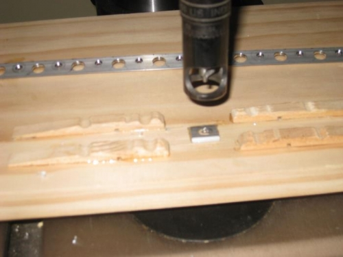 The small wedge is glued to the board and supports the trailing edge level