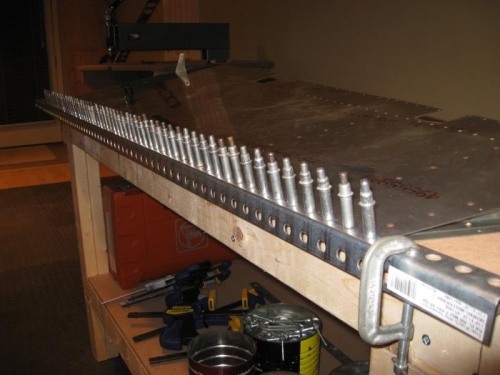 Trailing edge clecoed to steel angle