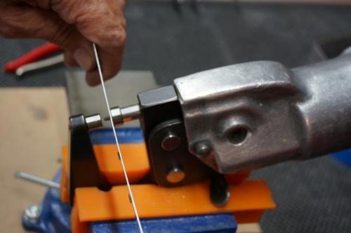 Dimpling rudder bottom attach strips