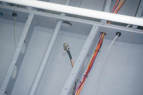 Wire bundle fastened to under floor structure and ADS-B coax