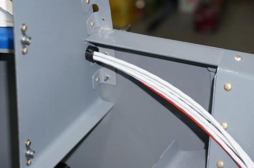 Headset wires through instrument panel