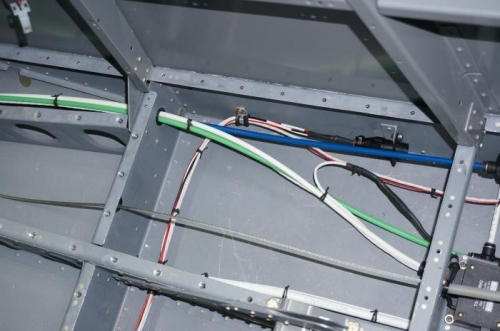 LH wing wire bundle secured with string ties