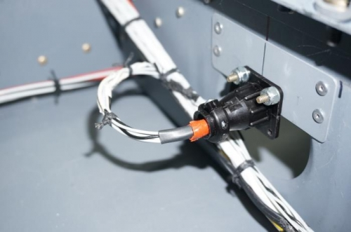 Rear stick CPC receptical mounted to cabin floor rail