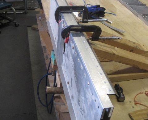 Center spar clamped for work