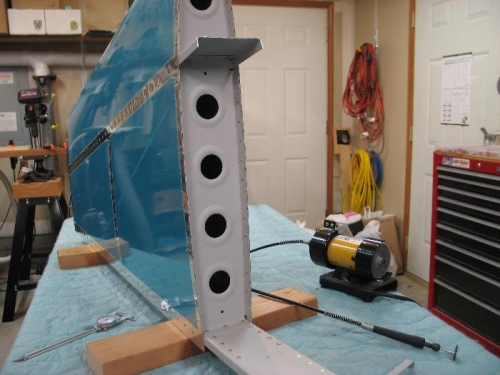 Trim vertical Fin forward spar.