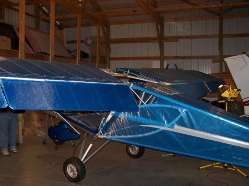 after wings are installed.  The wings are installed with the flaps and ailerons off.