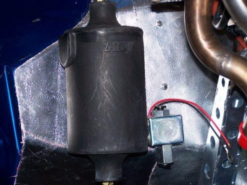 Oil overflow bottle and electric fuel pump
