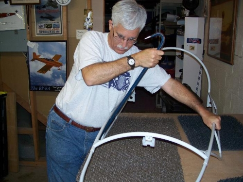 Using a crow bar to bend the canopy frame
