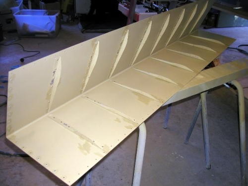 Stiffeners back rivted to aileron skin