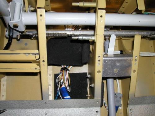 Under pilots seat wire bundle for sticks, flaps, strobes, lights etc.