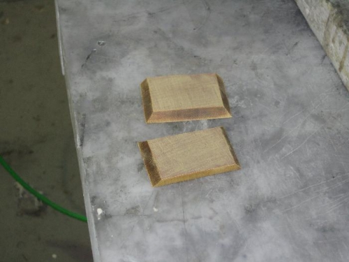 Elevator stops in phenolic board.