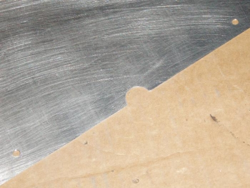 Notch in cover to clear bolt head
