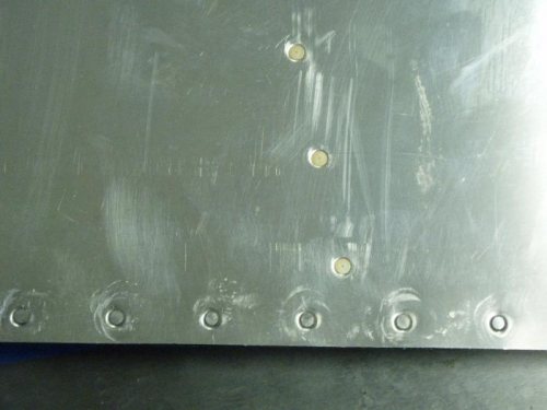 Ripples and rivet set marks