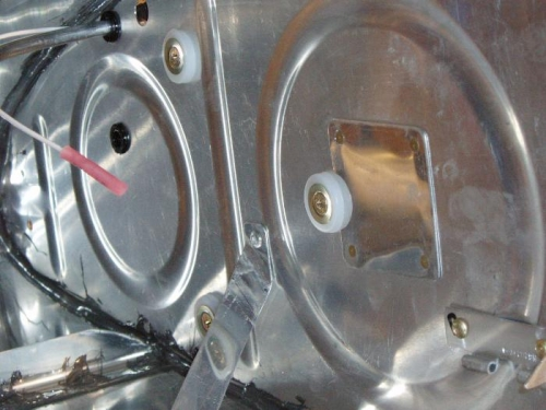 Screws holding capacitance plate