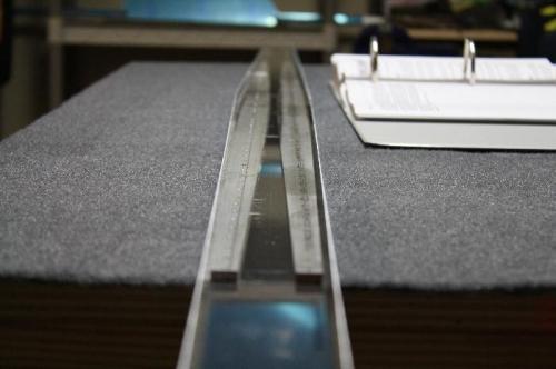 Rear spar reinforcement bars inside spar channel