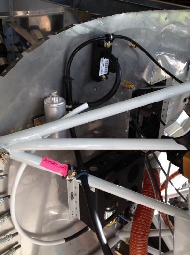 MP sensor line secured to engine mount